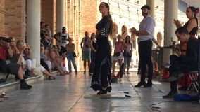 Group of flamenco dancers. SEVILLE, SPAIN - CIRCA OCTOBER 2017: Group of flamenco dancers in Plaza de Espana in Seville, Spain stock video footage