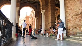 Group of flamenco dancers. SEVILLE, SPAIN - CIRCA OCTOBER 2017: Group of flamenco dancers in Plaza de Espana in Seville, Spain stock footage