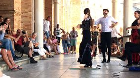 Group of flamenco dancers. SEVILLE, SPAIN - CIRCA OCTOBER 2017: Group of flamenco dancers in Plaza de Espana in Seville, Spain
