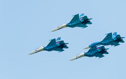 Group flight of russian pilotage team on SU-27 Stock Photos