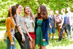 Group flirting young people Stock Images