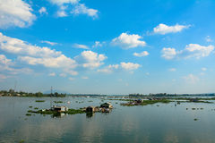 Group of floating house on lake in southern Vietnam. Life of Asian fisherman on La Nga river, group of floating house in residence of fishing village, people royalty free stock photo