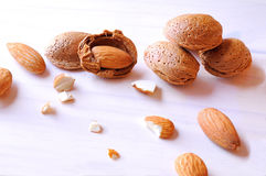 Group fo almonds on a white table top view Stock Image