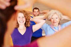 Group following fitness trainer instructions Stock Photos