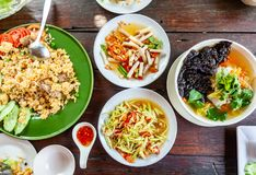 Group of Food Som Tam,Tum Lai Bua or Lotus Root Salad, Pork Stir. Rice and Seaweed Soup with Pork on Wood Table, Thai Food stock images