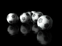 Group of football in dark background Royalty Free Stock Photo