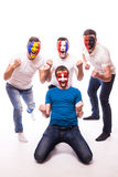 Group of football fans support their national team at camera Stock Image