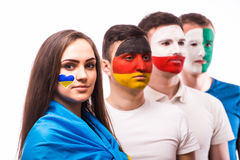 Group of football fans support their national team: Ukraine, Germany, Poland, North Ireland Stock Photos