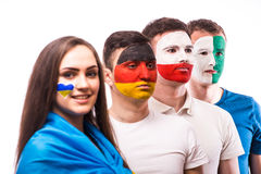 Group of football fans support their national team: Ukraine, Germany, Poland, North Ireland Royalty Free Stock Image
