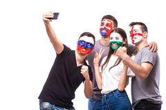 Group of football fans their national team: Slovakia, Wales, Russia, England take selfie photo Stock Photography