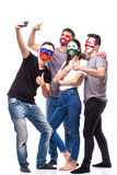 Group of football fans their national team: Slovakia, Wales, Russia, England take selfie photo Royalty Free Stock Photo