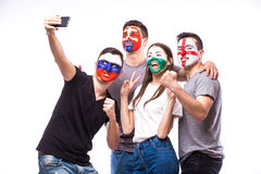 Group of football fans their national team: Slovakia, Wales, Russia, England take selfie Stock Photo