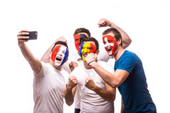 Group of football fans of their national team taking selfie photo Stock Images