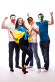 Group of football fans their national team: Ukraine, Germany, Poland, Northern Ireland take selfie Royalty Free Stock Photos