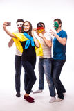 Group of football fans their national team: Ukraine, Germany, Poland, Northern Ireland take selfie Stock Image