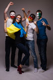 Group of football fans their national team: Ukraine, Germany, Poland, Northern Ireland take selfie Royalty Free Stock Images