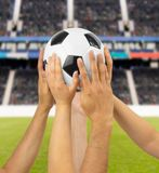 We have the ball. Group of football players holding a soccer ball at football stadium Royalty Free Stock Photo