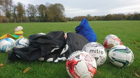 A group of footballs ball bag and cones Royalty Free Stock Images