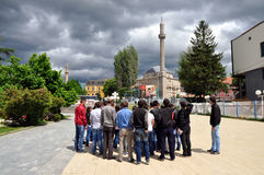 The group of foreign tourists visiting the old part of Prishtina. Kosovo stock photography