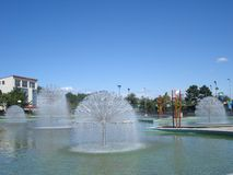 Group of fountains in water basin Royalty Free Stock Photos
