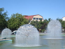 Group of fountains in water basin Royalty Free Stock Images