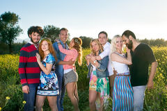 Group of four affectionate young couples. royalty free stock image