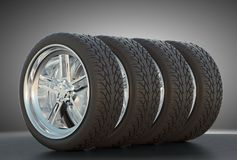Group of four automotive wheels with studio light Royalty Free Stock Photography