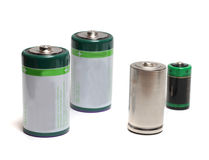 Group of four batteries. Diverse group of four batteries on a white background Royalty Free Stock Photography