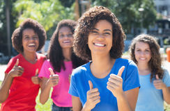 Group of four beautiful young woman showing thumb up royalty free stock image