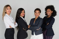 Group Of Four Businesswomen. Group of four hispanic and african american businesswomen royalty free stock images