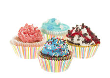 Group of Four Colorful Cupcakes Isolated Stock Photos