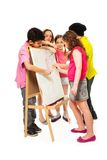 Five kids painting Stock Image
