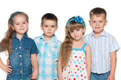 Group of four fashion children Stock Image