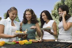 Group Of Four Females Enjoying A Barbecue Royalty Free Stock Photography