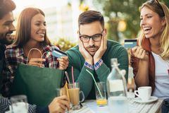 Group of four friends having fun a coffee together Stock Images