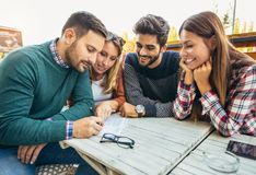 Group of four friends having fun a coffee together. Stock Photos