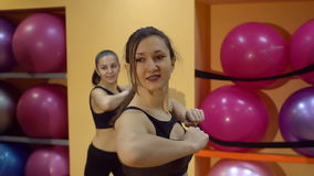Group of four girls doing exercises in the gym, slow motion. stock video