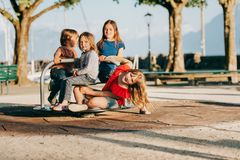 Group of four kids having fun on playground stock photography