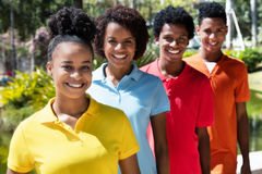 Group of four latin american young adult in line Stock Images