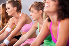 Group of four people spinning in gym Royalty Free Stock Photo