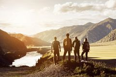 Group four people mountains travel concept Stock Photography