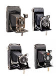 Group of four photocamera on medium format with bellows isolated. Group of four photocamera on medium format with bellows built in the last century stock image