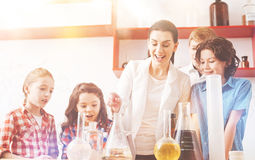 Group of four pupils standing around their teacher Royalty Free Stock Photography