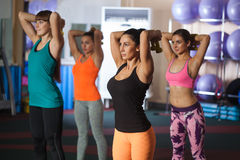 Group of four women traning with dumbbells Stock Photography