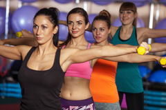 Group of four women traning with dumbbells Royalty Free Stock Images