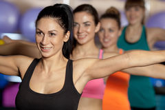 Group of four women traning in the gym Stock Images