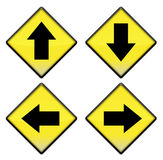 Group of four yellow road signs with arrows Stock Photo
