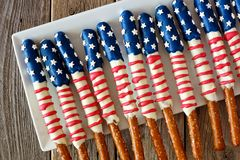 Group of Fourth of July American flag pretzel rods. Group of Fourth of July American flag themed pretzel rods on a white plate stock photo