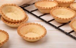 Group of fresh baked empty tart shells Royalty Free Stock Images