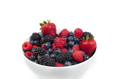 A group of fresh berries in a bowl Royalty Free Stock Images